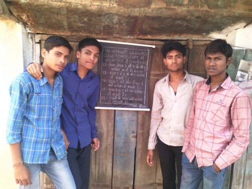 Children of Paradsingha and their weather board